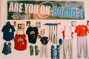 Baseball equipment on a wall.