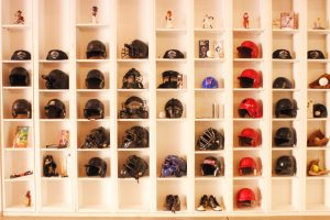 Baseball helmets on shelves.