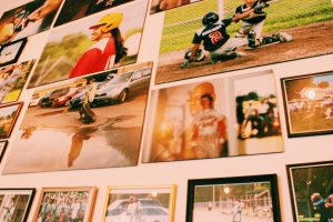 Old baseball photos on a wall.