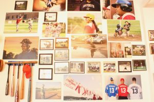Framed and mounted baseball photos.