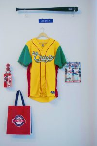 Chiefs baseball gear on a wall.